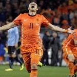Arjen Robben celebrates after scoring the third goal for the Netherlands.
